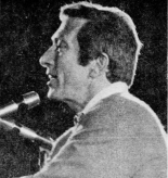 Andy Williams singing at a piano