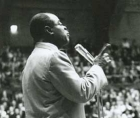 Louis Armstrong, performing at UC
