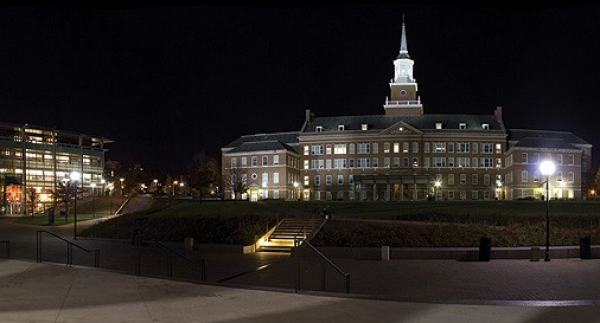 McMicken and University Pavilion lit up at night.