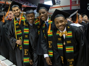 UC Students smile before taking their seats during morning Commencement ceremony Saturday May 2, 2015 at Fifth Third Arena. UC/Joseph Fuqua II