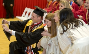 UC Students takes a selfie during morning Commencement ceremony Saturday May 2, 2015 at Fifth Third Arena. UC/Joseph Fuqua II