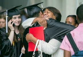 Student got a big hug during the afternoon Commencement. UC/Andrew Higley