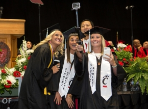 UC Students Athletes use a GoPro on a stick to take a selfie with UC President Santa Ono, middle during morning Commencement ceremony Saturday May 2, 2015 at Fifth Third Arena. UC/Joseph Fuqua II