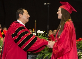 UC Student Christina Beer, right shakes hand with President Santa Ono during morning Commencement ceremony Saturday May 2, 2015 at Fifth Third Arena. UC/Joseph Fuqua II