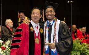 UC President Santa Ono, left pose with Brandon Reynolds during morning Commencement ceremony Saturday May 2, 2015 at Fifth Third Arena. UC/Joseph Fuqua II