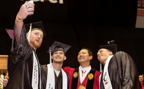 UC Students Athletes take a selfie with UC President Santa Ono, middle during morning Commencement ceremony Saturday May 2, 2015 at Fifth Third Arena. UC/Joseph Fuqua II