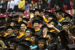 A UC student waved to her family during the Doctoral Hooding & Master's Recognition Ceremony Friday May 1, 2015 at Fifth Third Arena. UC/Joseph Fuqua II