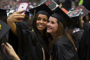 UC students posed as they take a selfie during Commencement. UC/Andrew Higley