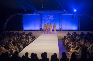 Models display student designs at the 2015 DAAP Fashion Show