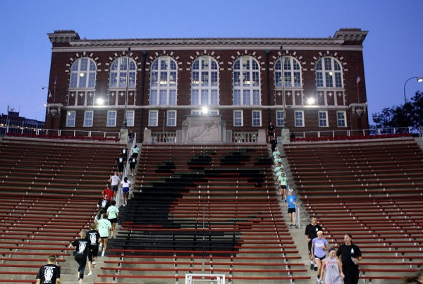 Members of the UC community take part in the 9/11 Stadium Stair Run in front of the Dieterle Vocal Arts Center.