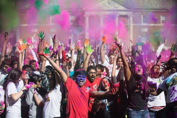 UC students take part in Holi Festival on McMicken Commons by throwing colors.