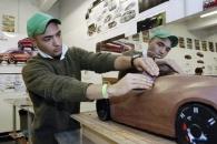 A UC student sculpts a car model.
