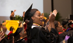 A UC student claps her hands at 2017 Tyehimba, the 26th annual Afro-centric graduation celebration.
