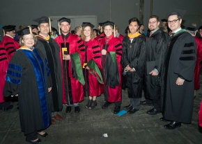 UC students and faculty gather before the  Doctoral Hooding and Master's Recognition Ceremony