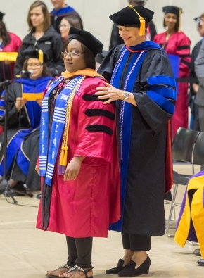 A doctoral grad is hooded at the Doctoral Hooding and Master's Recognition Ceremony