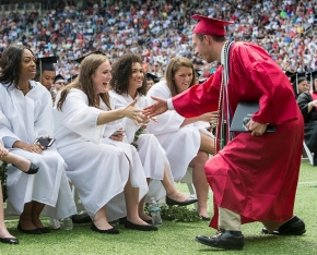 Grads shake hands at Nippert Stadium