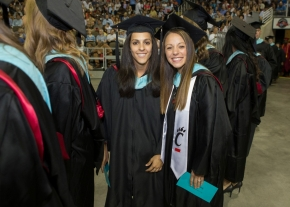 Two UC undergraduate degree recipients pose for the camera