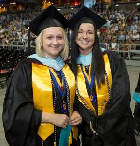 Two UC students pose for the camera.