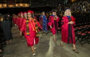 Master's degree recipients enter BB&T Arena for UC's Commencement exercises.