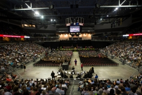A wide shot of the stage, nearly 2,000 UC graduates, and their families in the stands at BB&T Arena.