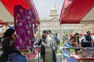 Students browse booths at Worldfest.