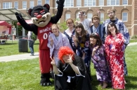 The Bearcat mascot with students.