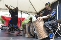 Performing African music and dance.
