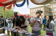 Students browse the booths at Worldfest.