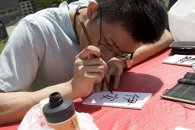 Painting Chinese characters at worldfest.