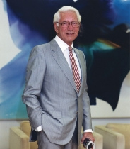 Carl Linder Jr. standing for a posed portrait