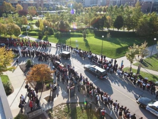 hearse passing in front of College of Business