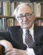 President emeritus Henry Winkler, sitting in his Langsam Library office.