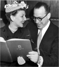Jerry Berns and actress Mary Martin, looking over a  menu at the 21 Club