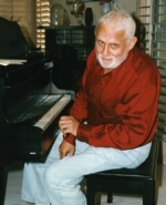 Al Hague at the piano in his living rooom in 1998