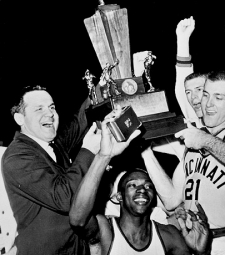 Coach Ed Jucker and his team hoist the 1961 national championship trophy.