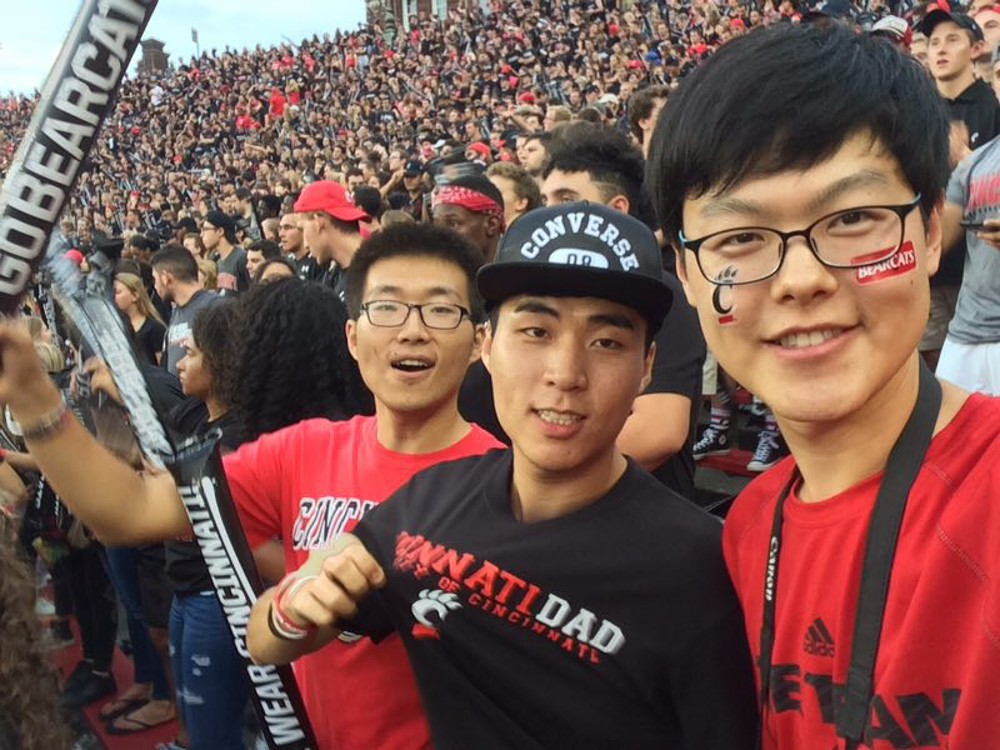 Chongqing University students cheer on the home team at a UC football game