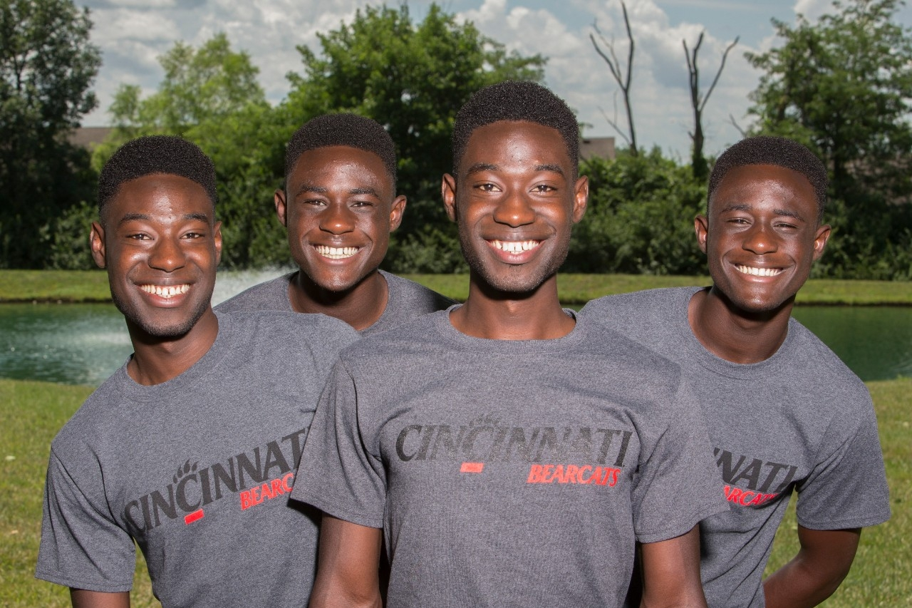 UC's double set of identical twins from same family, the four Mantey sons, stand together. photo/Joseph Fuqua II/UC Creative Services