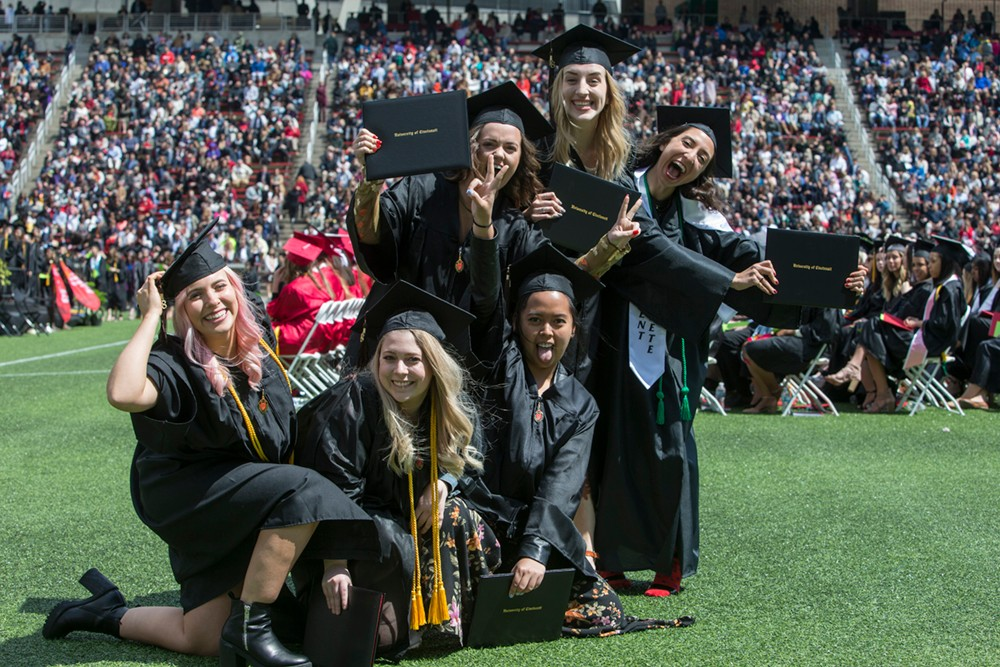 UC grads ham it up after receiving their diplomas.