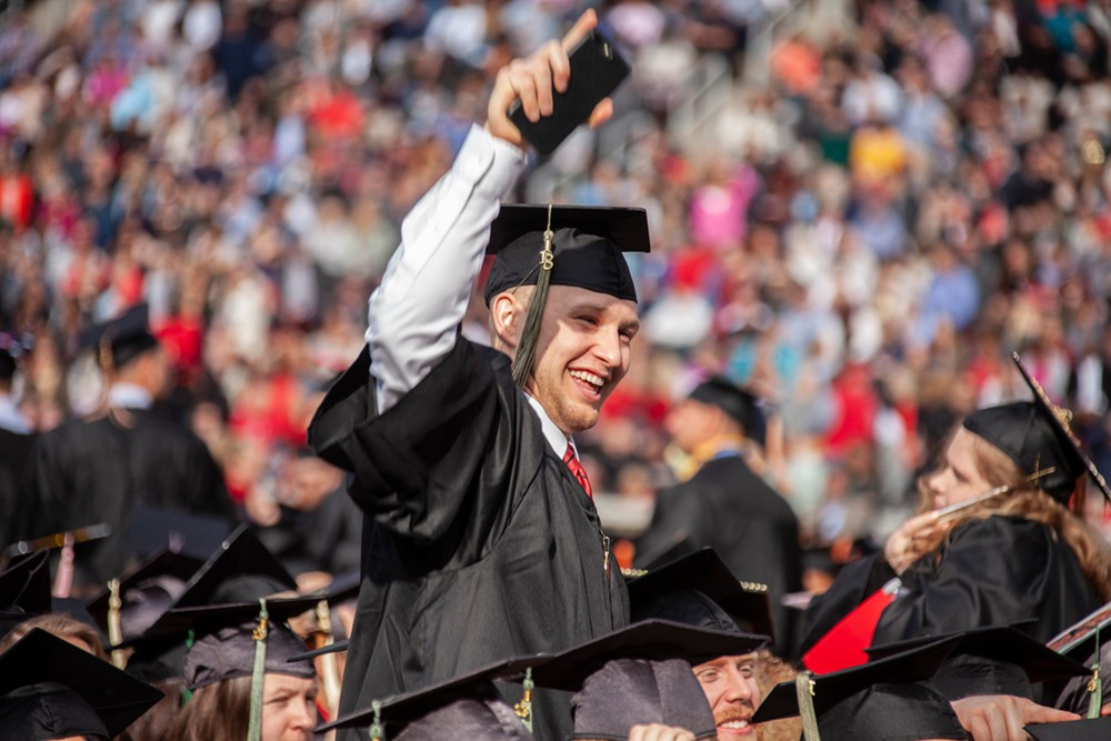 Happy graduate at UC's commencement.