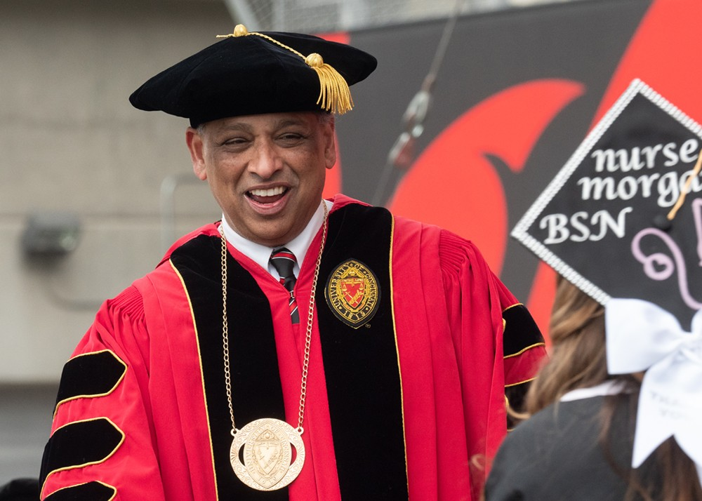 President Neville Pinto shares a laugh with a student.