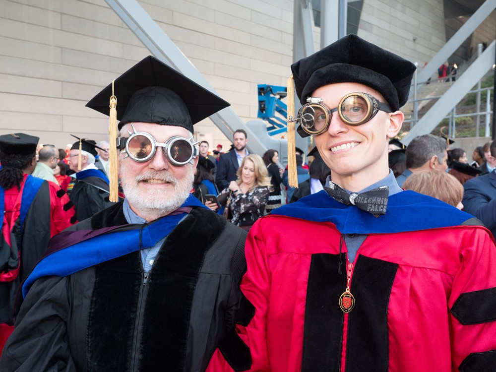 Two men in robes wearing steampunk goggles.