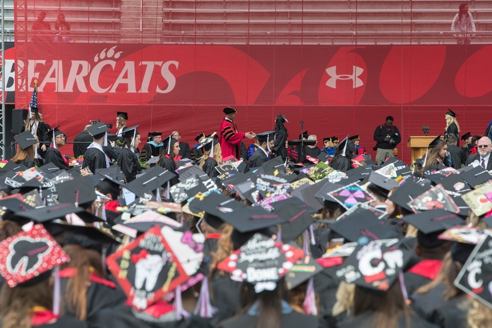 A view from the crowd at Spring 2018's undergraduate Commencement ceremony, with dozens of decorated mortarboards