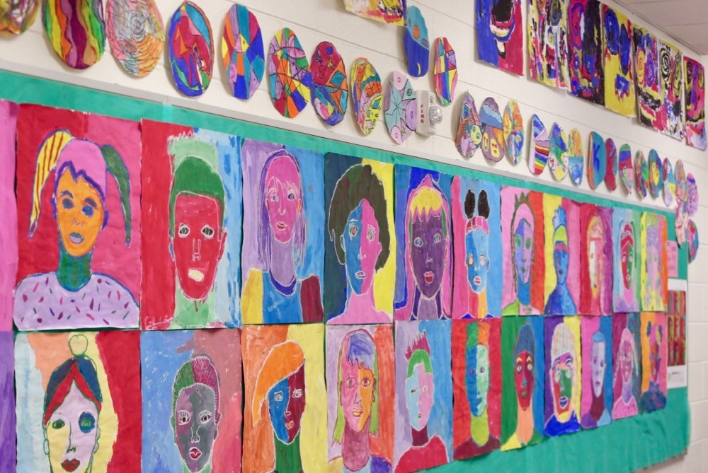 Colorful art adorns the walls of Cincinnati's Woodford Paideia Academy, school for arts education.