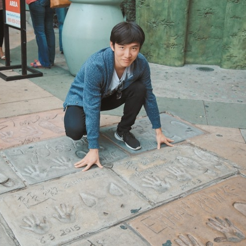 Visiting Hollywood's Walk of Fame featuring Chinese movie stars Huang Xiaoming and Zhao Wei.
