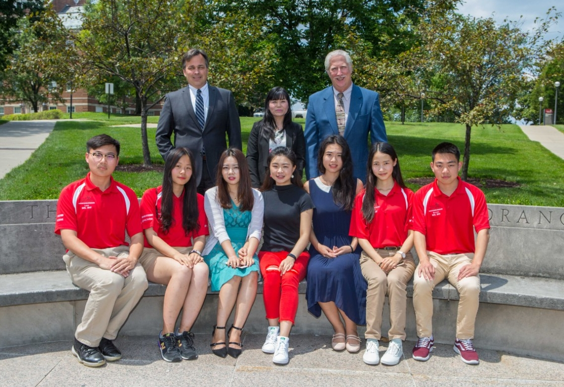 "UC will celebrate the graduation of 56 engineering students in a partnership with Chongqing University. Pictured are UC College of Engineering and Applied Science Interim Dean Paul Orkwis, left, program coordinator Xiaoqun ""Sherry"" Liao and Associate Dean of Undergraduate Affairs Arthur Allen. Seated from left are students Jinglun Yu, Yuelin Fan, Yixuan Zhang, Zijia Shen, Jingyi Zhu, Lingchi Li and Zhihao Sun. (Photo by Andrew Higley/UC Creative Services)"