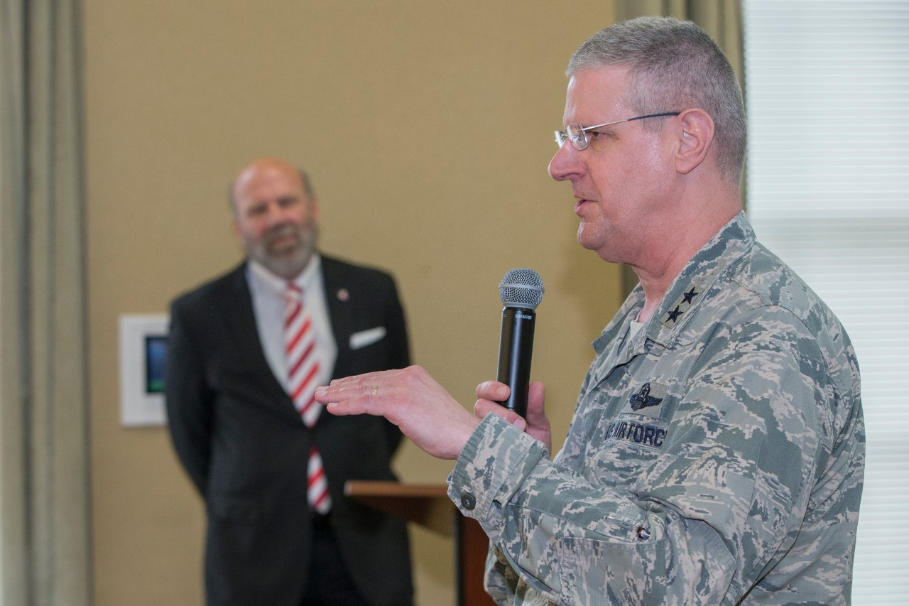 Maj. General Mark Bartman, the adjutant general of the Ohio National Guard, speaks at the ribbon cutting for the Ohio Cyber Range as OCR director Stephen J Smith looks on.