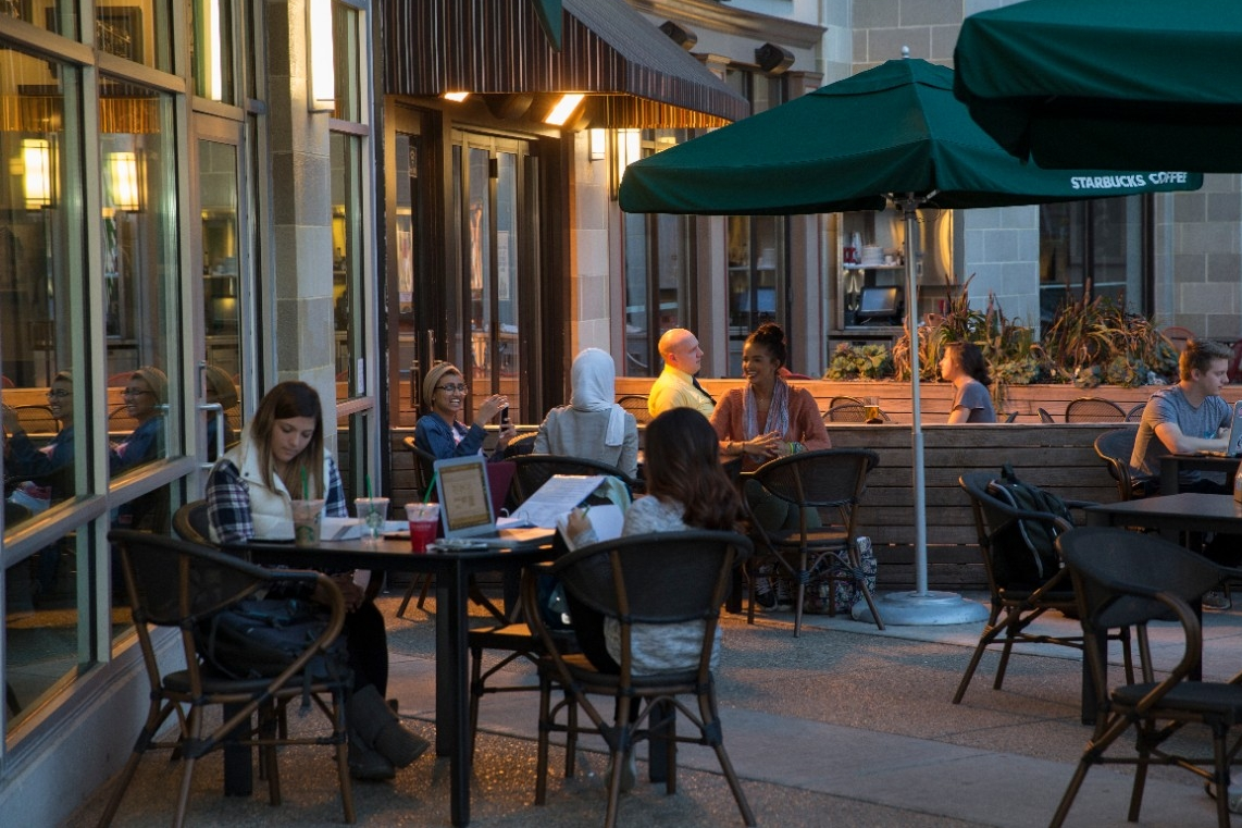 Students and community members enjoy a cup of coffee at USquare's Starbucks on Calhoun Street. Photo/Lisa Ventre