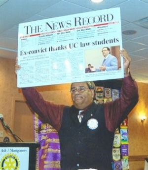 "Gary Reece proudly displays an oversized copy of the News Record's front page, which declares: ""Ex-convict thanks UC law students."""
