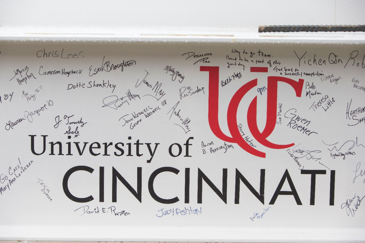 Signatures adorn the final beam.