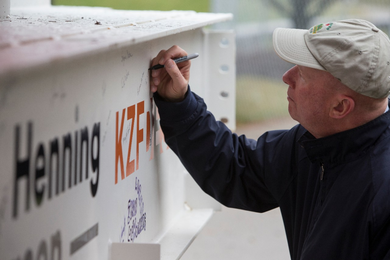 A guest signs the final beam.